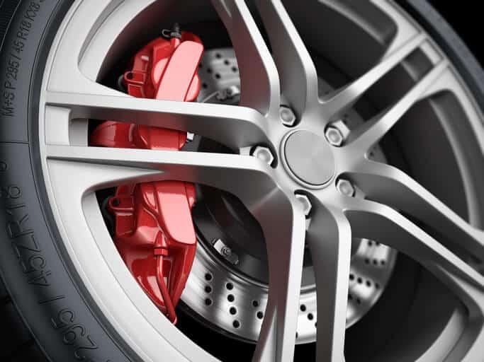 Car wheel and brake system. Red caliper, sport tire.